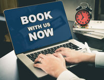Online Travel Agency website Book Now on screen. Stock Photo