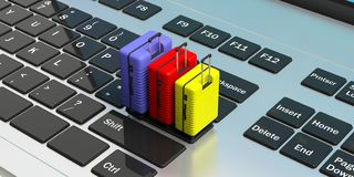 Three bright colors and various sizes suitcases isolated on a computer keyboard. 3d illustration stock illustration