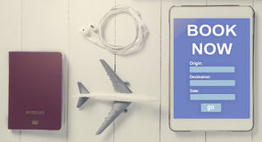 Online Travel booking on Tablet. Traveller using online travel agency to book accommodation. Royalty Free Stock Images