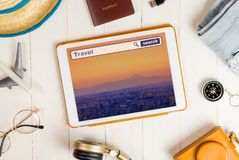 Online travel search on Tablet tokyo background Royalty Free Stock Photos
