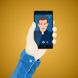 Online video conferencing. Hand with phone vector illustration in flat style. Royalty Free Stock Images