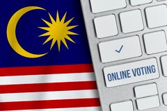 Free Online Voting Concept In Malaysia. Keyboard Near Country Flag Stock Photography - 188031982
