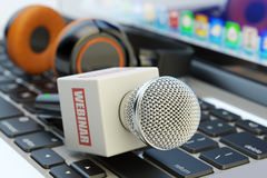 Online web seminar, internet communication, e-learning and distance studying concept. Microphone with word webinar and modern headphones on laptop keyboard Stock Photography