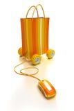 Online winkelend in sinaasappel Stock Fotografie