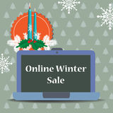 Online winter sale. Colorful illustration with two burning candles, winter decorations and a laptop with the text online winter sale written on its screen Stock Photos