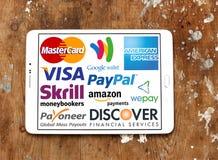 Online-Zahlungs-Dienstleistungen und Systemlogos und -vektor Lizenzfreie Stockfotos