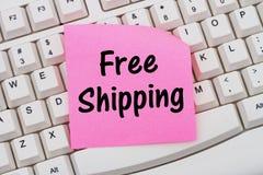 Online zakupy z Bezpłatną wysyłką, komputerowy kleisty i klawiatura obrazy royalty free