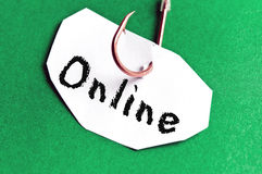 Onlinemeldung auf Papier Lizenzfreie Stockfotos