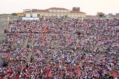 Onlookers on a concert in Arena of Verona Stock Photos