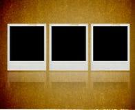 Onmiddellijk fotoframe tegen een grungy textuur royalty-vrije stock foto