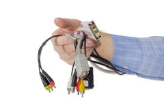 Сonnectors for computers and gadgets in a man's hand Royalty Free Stock Image