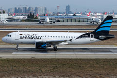 5A-ONO Afriqiyah Airways, flygbuss A320-200 Arkivbild