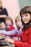 Ono edukacja z dziećmi w szkole Obrazy Stock