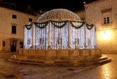 Onofrio fountain decorated with Christmas lights and ornaments, Dubrovnik. Onofrio fountain decorated with Christmas lights and ornaments, shining in the Stock Photo
