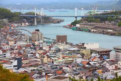 Onomichi, Japan. Town in the region of Chugoku. Aerial view with highway bridge royalty free stock photos