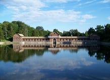 Onondaga Park Bathhouse Reflection. Historic bathhouse at Onondaga Park, Syracuse, NY, and cloudy sky reflected in lake Stock Photos