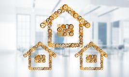 Onroerende goederen of bouwidee door huispictogram wordt voorgesteld op witte bureauachtergrond die Stock Foto's