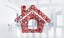 Onroerende goederen of bouwidee door huispictogram wordt voorgesteld op witte bureauachtergrond die Royalty-vrije Stock Afbeeldingen