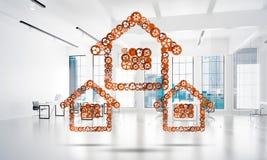 Onroerende goederen of bouwidee door huispictogram wordt voorgesteld op witte bureauachtergrond die Royalty-vrije Stock Foto