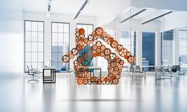 Onroerende goederen of bouwidee door huispictogram wordt voorgesteld op witte bureauachtergrond die Royalty-vrije Stock Afbeelding