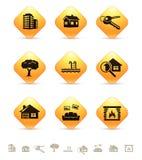 Onroerende goederenpictogrammen op gele knopen Royalty-vrije Stock Afbeeldingen