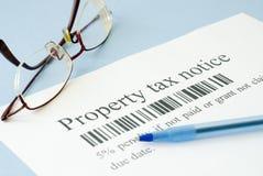 Onroerendgoedbelastingbericht Stock Foto