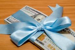 ons dollar in blauw lint Royalty-vrije Stock Foto