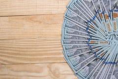 ons dollar op houten bureau Royalty-vrije Stock Afbeelding