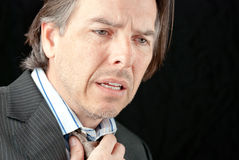 Onset of a Heart Attack. Close-up of a businessman experiencing the onset of a heart attack Stock Photos