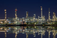 Onshore refinery in twilight to exact hydrocarbon to fuel and petrochemical product. Down stream of onshore oil and gas product,Oil and gas refinery in Thailand stock image