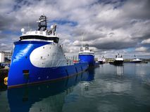 Onshore Supply Base A. Onshore oil industry supply vessel base for offshore oil rig and platform operations Stock Photos