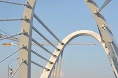 Сonstruction cranes and Lazarevsky bridge Stock Image