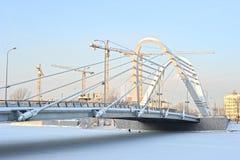 Сonstruction cranes and Lazarevsky bridge Royalty Free Stock Photography
