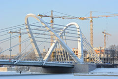 Сonstruction cranes and Lazarevsky bridge Royalty Free Stock Images