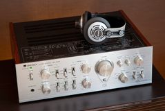 Ontario, Canada - December 22 2017: Vintage Audio Stereo Amplifier with Headphones Side View. Vintage Audio Stereo Amplifier with Headphones Side View Optonica royalty free stock photo