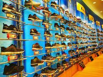 Sport Shoes on Racks stock image