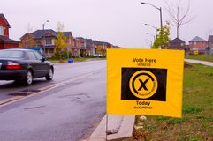 Ontario Elections. Yellow electoral English-French bilingual sign identifying the voting location Stock Image