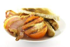 Ontbijt en Toost op een Witte Plaat Royalty-vrije Stock Fotografie