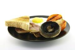 Ontbijt en Toost op een Zwarte Plaat Royalty-vrije Stock Fotografie