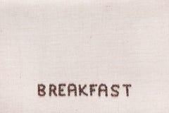 Ontbijt met koffiebonen wordt, in centrum bij de bodem worden gericht geschreven die royalty-vrije stock afbeelding