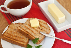 Ontbijt met toost en boter Royalty-vrije Stock Afbeelding