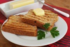 Ontbijt met toost en boter Royalty-vrije Stock Afbeeldingen