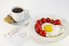 Ontbijt van gebraden eieren en tomaten Royalty-vrije Stock Fotografie