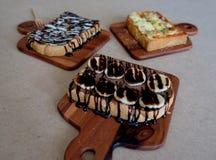 Ontbijttoost, Pizza, bananenchocolade, chocoladepinda Stock Fotografie
