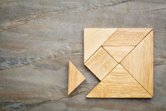 Ontbrekend stuk in tangram raadsel Royalty-vrije Stock Foto's