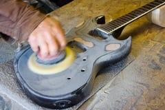 Ontdoend van een gitaar eindig stock foto