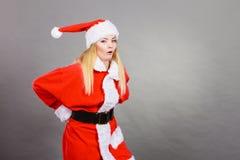 Ontevreden vrouw die Santa Claus-helperkostuum dragen Royalty-vrije Stock Foto