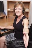 Onthaal aan haar bureau Stock Fotografie