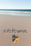 Onthaal dat op een strand wordt geschreven australië Royalty-vrije Stock Foto's