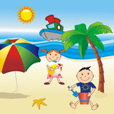 Onthe beach. Childs on the beach with umbrella Royalty Free Stock Image